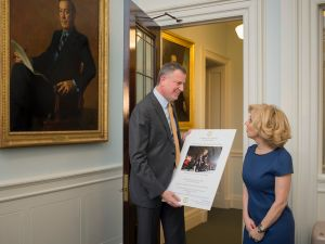 """Mayor de Blasio receives his invitation to the Inner Circle Show from Beth Karas, Inner Circle's President, on Wednesday, March 5, 2014. The Inner Circle was created in 1923 to """"have fun and entertain ... by parodying New York City, state and national politics. Each year the proceeds of the show go toward helping dozens of small charities selected by members."""" (Photo: Rob Bennett for the Office of Mayor Bill de Blasio"""