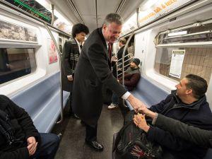 Bill de Blasio is shaking hands, not panhandling. (Photo: NYC Mayor's Office)