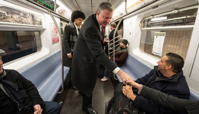 Bill de Blasio is shaking hands, not panhandling. (Photo: NYC Mayor's Office)