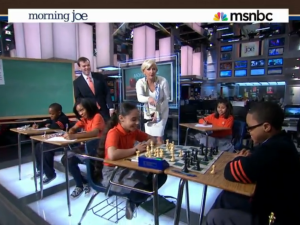 Mika with some charter school children. (embed: msnbc.com)