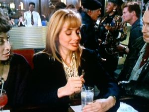 Rosanna Arquette as Paulette, Lione's assistant/former girlfriend, and Buscemi as Gregory Stark. (Courtesy http://buscemovies.tumblr.com)