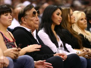 Donald Sterling and V. Stiviano enjoy courtside seats in 2013.