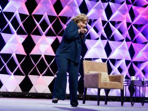 Former Secretary of State Hillary Clinton ducks after a woman hurled a shoe at her as she was delivering remarks at the Institute of Scrap Recycling Industries conference on April 10, 2014 in Las Vegas, Nevada. (Photo: Isaac Brekken/Getty Images)