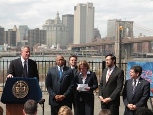Mayor Bill de Blasio and other Brooklyn and Queens pols at today's event. (Photo: Ed Reed/NYC Mayor's Office.)