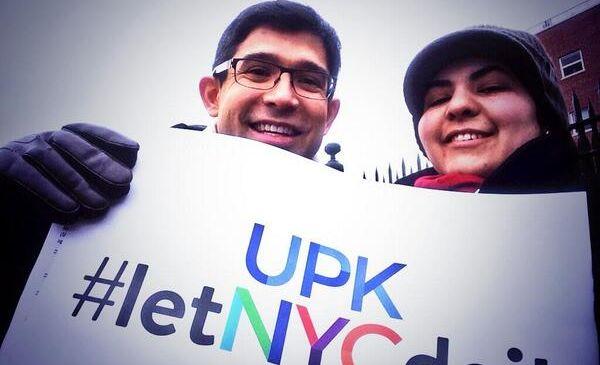 Councilman Carlos Menchaca brandishing a UPKNYC sign. (Photo: Twitter/@UPKNYC)