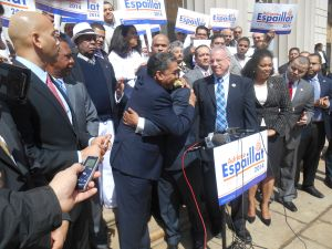 State Senator Adriano Espaillat embraces the Bronx Democratic chairman as Bronx Borough President Rubén Díaz, Jr. looks on (right).