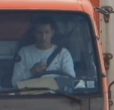 A truck driver using his phone. (Screengrab via ABC News)