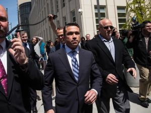 Congressman Michael Grimm walking out of Brooklyn Federal Court. (Photo: Andrew Burton/Getty)