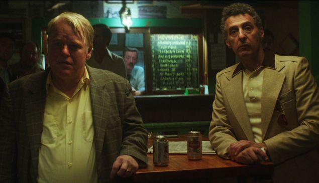 Philip Seymour Hoffman, left, and John Turturro in God's Pocket.
