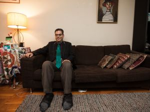 Michael Musto at home in his Murray Hill apartment. (Photo by Emily Assiran)