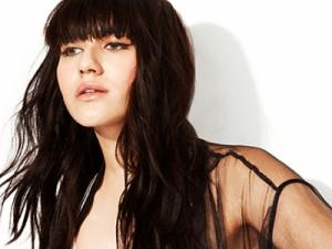 Blogger and model Natalie Suarez in DKNY. (Screengrab via DKNY)