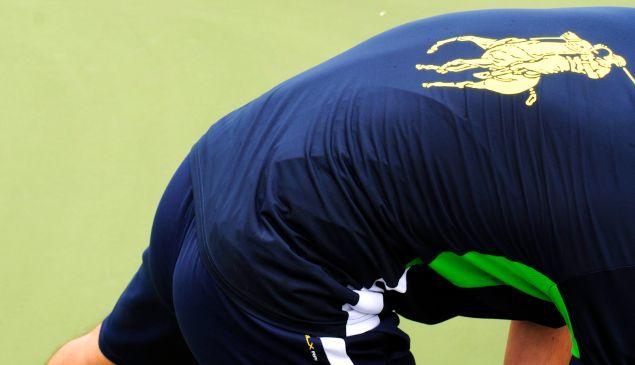 A prospective ball person stretches, wearing Ralph Lauren (Photo: Matt Mullen)