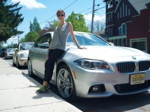 The author's travel companion poses with an automobile.