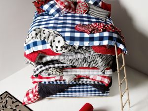 Collaborating with Hastens, Angela Missoni recreated a scene from the princess and the pea, with Missoni knit throws strewn into the mix. (Hastens)
