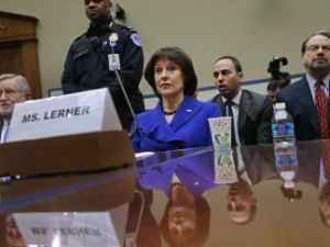 And the story continues: IRS official Lois Lerner takes the 5th Amendment before the House Oversight and Government Reform Committee, March 5, 2014 in Washington, DC. (Photo by Chip Somodevilla/Getty Images)