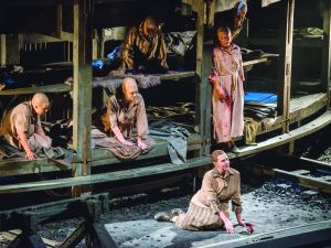 Soprano Melody Moore, lower right, in 'The Passenger.' (©Stephanie Berger)