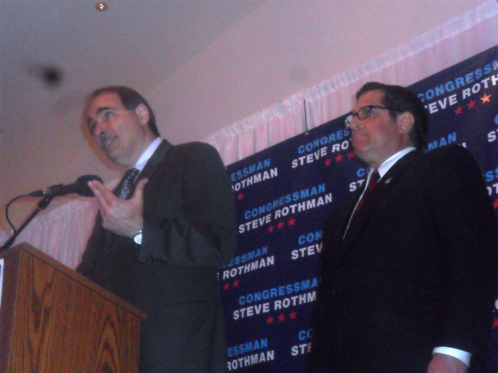 Axelrod embraces Rothman in front of Wood-Ridge crowd