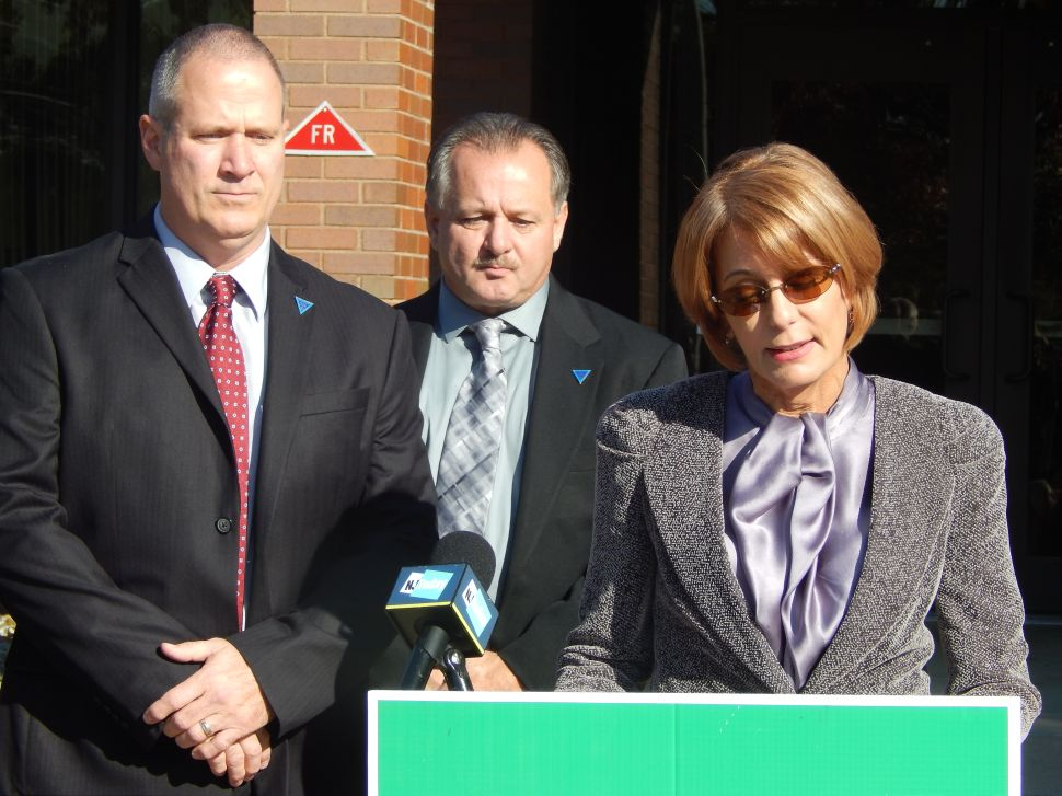 Standing with Superior Officers Association brass, Buono attacks Christie on pen/ben