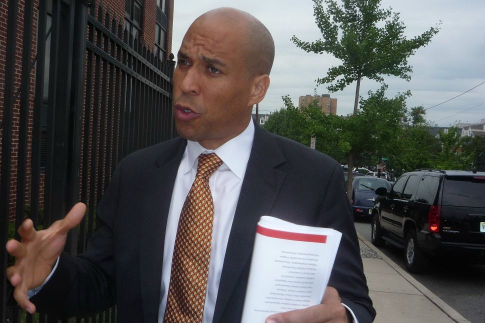 Booker says he won't have a formal campaign rollout until late next month