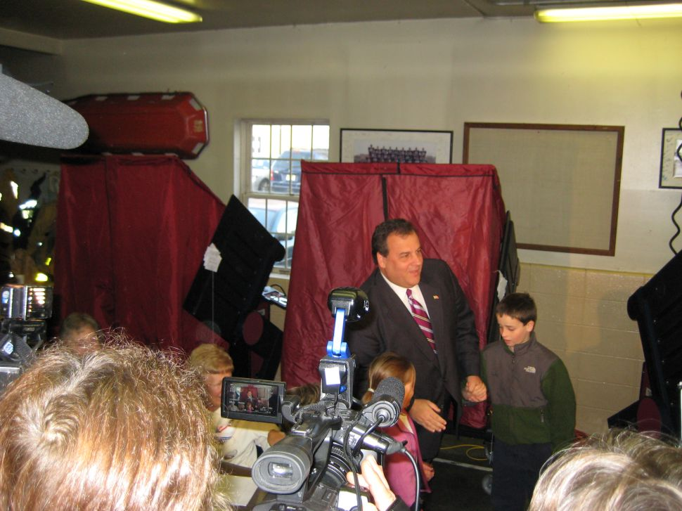 Christie casts his vote, says a victory for him will change the way state campaigns are run