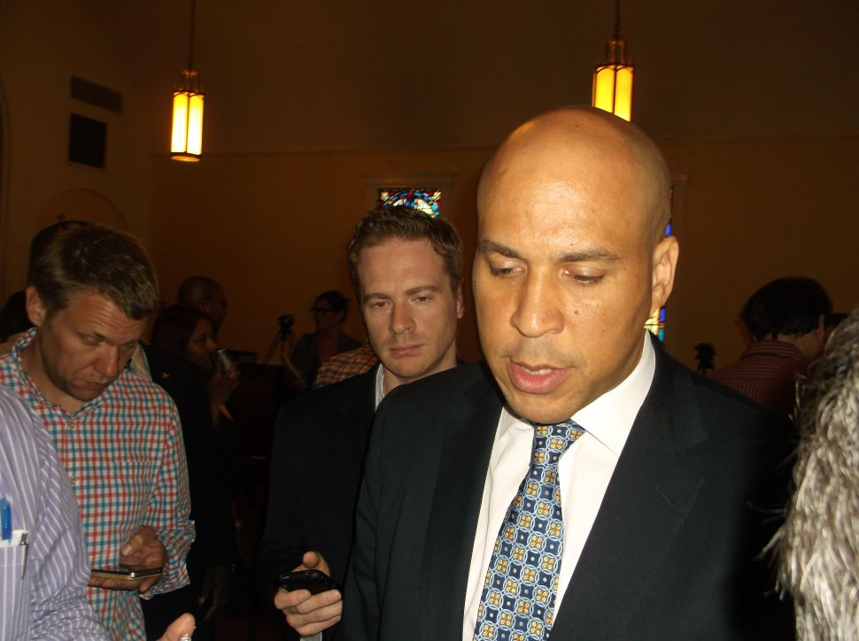 Booker says he will compete in two primary debates, but Pallone wants more