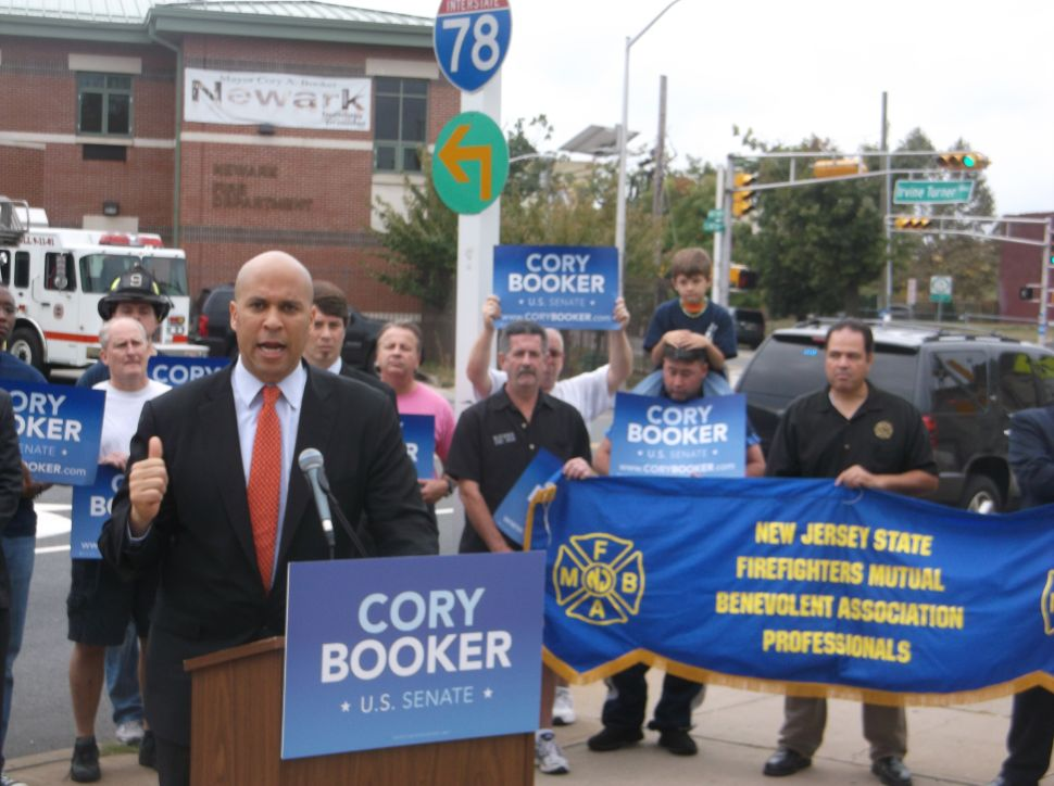 Booker draws line from shutdown, to firefighters facing layoffs, to Lonegan