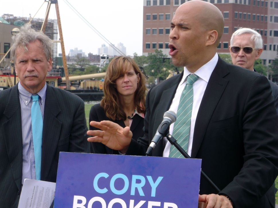 Booker thunders against enemies of global warming science but doesn't chastise Christie