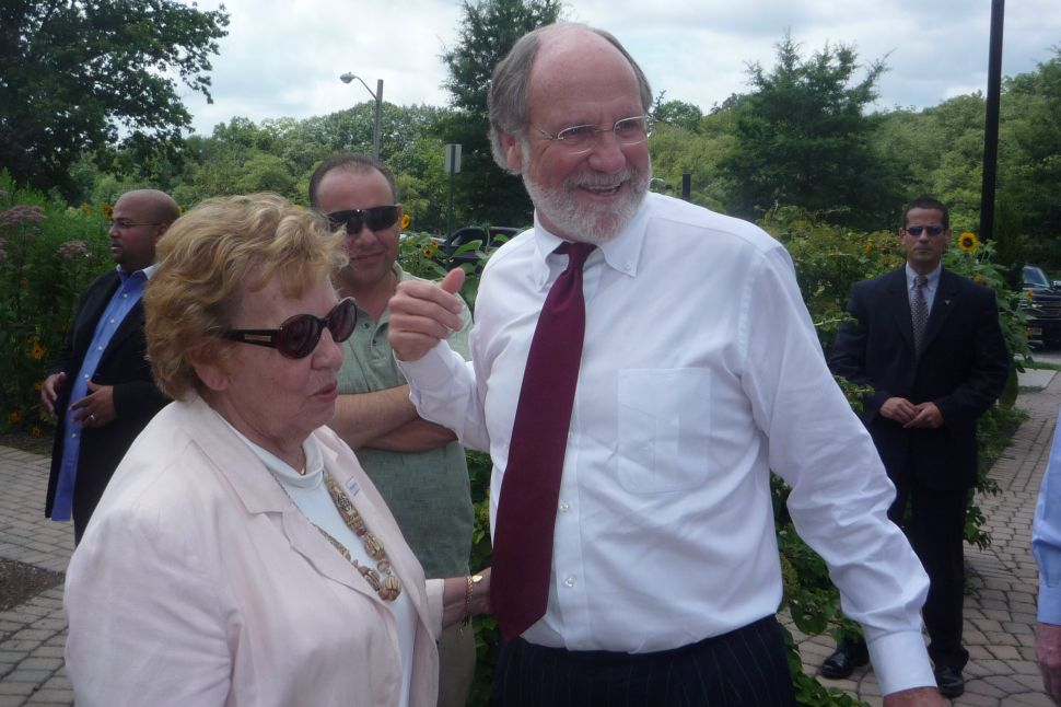 Corzine says he's enhancing not replacing campaign staff