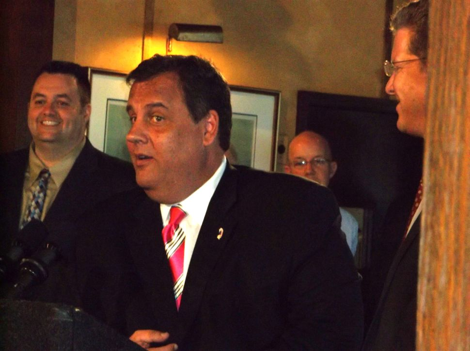 Welcoming Sandy aid, Christie not ready to stick a fork in the Tea Party