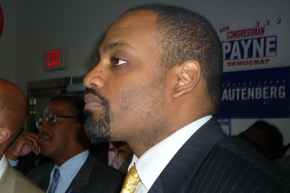 After running as a local Obama, Hawkins runs early into the hard edge of Orange