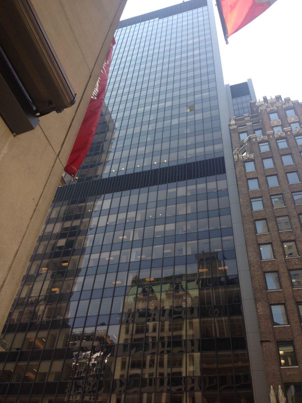 Broken Skyscraper Window Showers Glass Onto W. 57th Street, Injures 3