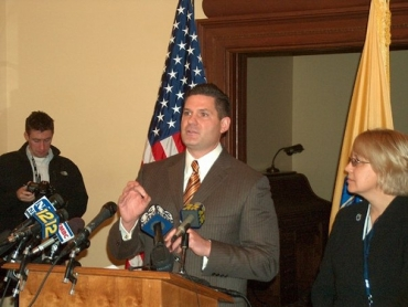 Budget Committee Democrats want Schundler, who's unavailable