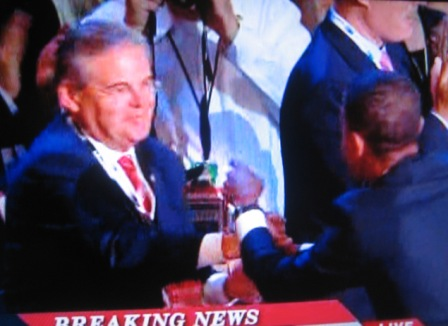 Menendez gets near the stage, shakes hands with Obama