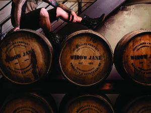 Head distiller Vince Oleson perched atop some Widow Jane barrels (Photos: Rick Wenner/For New York Observer).