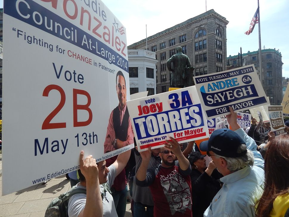 Coordinated protest by rival campaigns confronts Sayegh and Pascrell at City Hall
