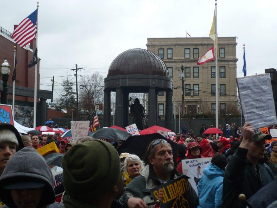 Labor rally heats up in the rain