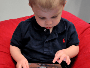 Somebody get this kid an iPad case. (Wikimedia Commons)