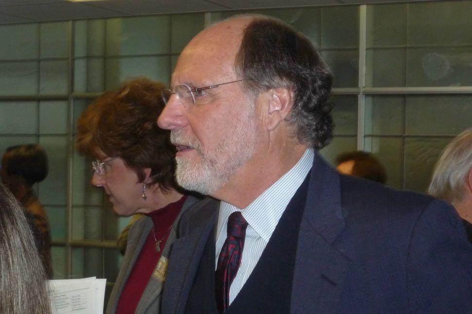Corzine takes budget battle to radio waves