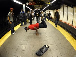 A subway performer dancing on a platform. (Timothy A. Clary/AFP/Getty Images)