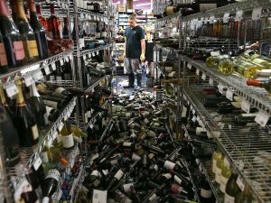 Wine bottles thrown from the shelves at a liquor store in Napa following an earthquake (Photo by Justin Sullivan/Getty Images)