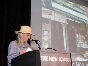 Unoppressive Non-Imperialist Bargain Books owner Jim Drougas accepts the Village Award this past June. (Facebook)