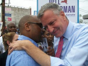 State Senator John Sampson huddles with Mayor Bill de Blasio. (Photo: Ross Barkan)