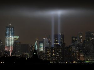 "The annual ""Tribute in Light ""memorial echoing the twin towers of the World Trade Center illuminates the night sky. (Photo by STAN HONDA/AFP/Getty Images)"