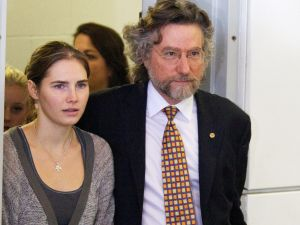 Despite powerful evidence pointing to another killer, Italian prosecutors have clung to their case against Amanda Knox, shown here with one of her lawyers in 2011. (Photo by Stephen Brashear/Getty Images)