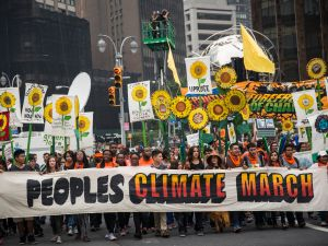 Protestors take to the street during the People's Climate March (Photo by Andrew Burton/Getty Images)