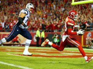 Husain Abdullah #39 of the Kansas City Chiefs scores a touchdown before his display of faith that was penalized. (Photo by Dilip Vishwanat/Getty Images)