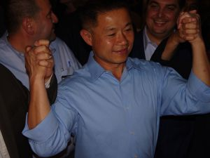 John Liu joins hands with supporters despite numbers showing him trailing Tony Avella (Photo: Will Bredderman).