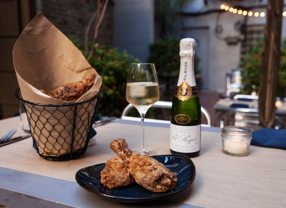 Bird's Lament: The Unfathomable Undertones of a Fried Chicken and Champagne Hotspot