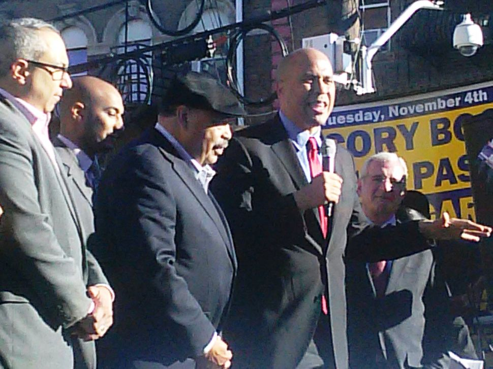 As Booker rallies Latinos in Passaic, Ebola joust with Bell persists
