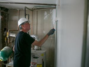Mayor Bill de Blasio painting a home in Coney Island. (Photo: William Alatriste/New York City Council)